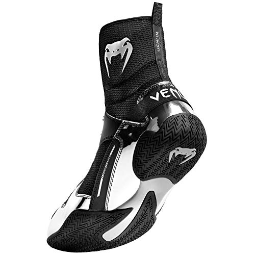 Venum Elite Boxing Shoes Tri-material: Shiny PU Patent, PU Flex, Mesh Honeycomb.  Rubber outsole: elevated grip, sturdiness and stability.  Optimized consolation with anatomical designed insole.  Bonded insole to stop slipping.