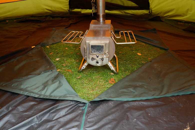 ...maar ook in een ruit zodat de kachel op het gras staat.