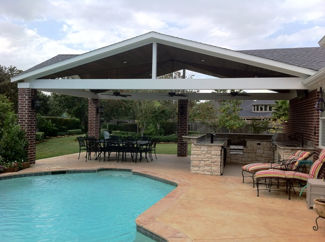 covered outdoor kitchen high table set custom kitchens homescapes by pool