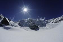 ENGADIN St. Moritz: Piz Palue mit der Sonne im Gegenlicht