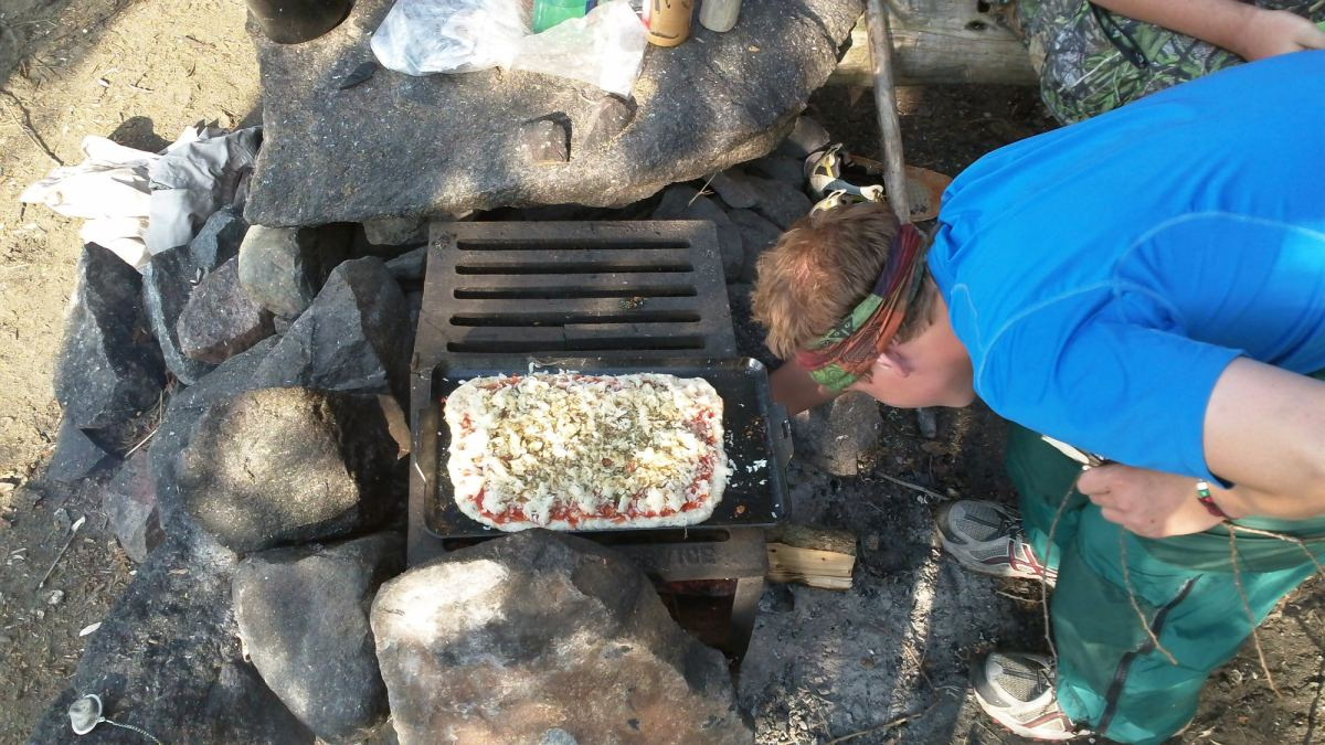 Pizza cooking over the fire in the BWCA