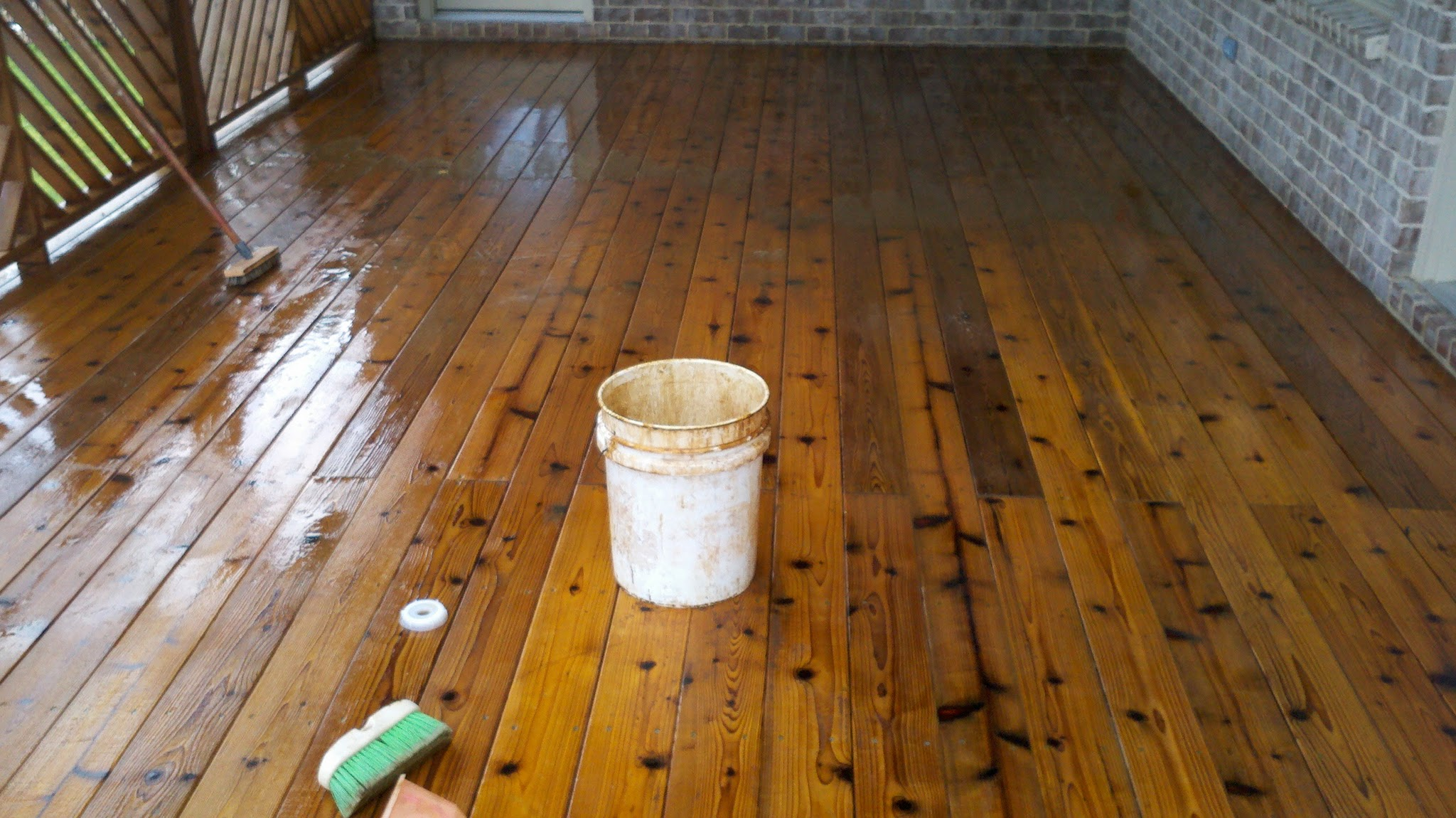 This photo shows deck stain removal in progress