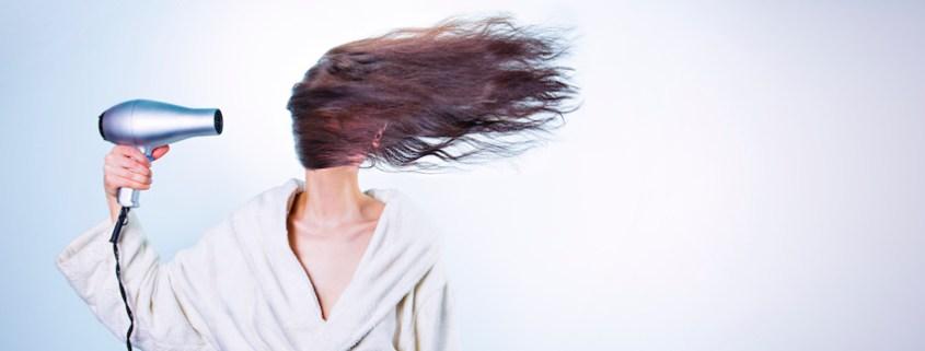 dry hair never again - woman-morning-bathrobe-bathroom