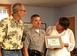 Dewey Parr, left, with Capt. Mark Evans and KDH Mayor Sheila Davies. Evans received  life saving award for reviving Parr after a heart attack.