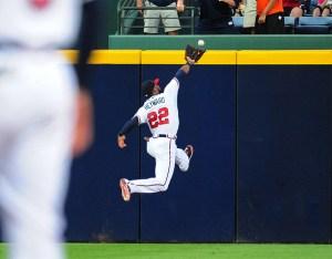 Jason Heyward makes a running catch. (Source: Scott Cunningham/Getty Images North America)