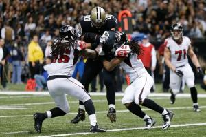 NEW ORLEANS, LA - DECEMBER 21: Jimmy Graham #80 of the New Orleans Saints catches a pass between Kemal Ishmael #36 and Dezmen Southward #41 of the Atlanta Falcons during the fourth quarter of a game at the Mercedes-Benz Superdome on December 21, 2014 in New Orleans, Louisiana. (Photo by Sean Gardner/Getty Images)