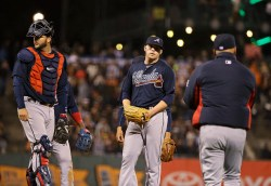 Atlanta Braves relief pitcher Brandon Cunniff, center, stands on the mound as manager Fredi Gonzalez, right, comes out to remove him during the eighth inning of the Braves' baseball game against the San Francisco Giants on Thursday, May 28, 2015, in San Francisco. At left is catcher A.J. Pierzynski. (AP Photo/Eric Risberg)