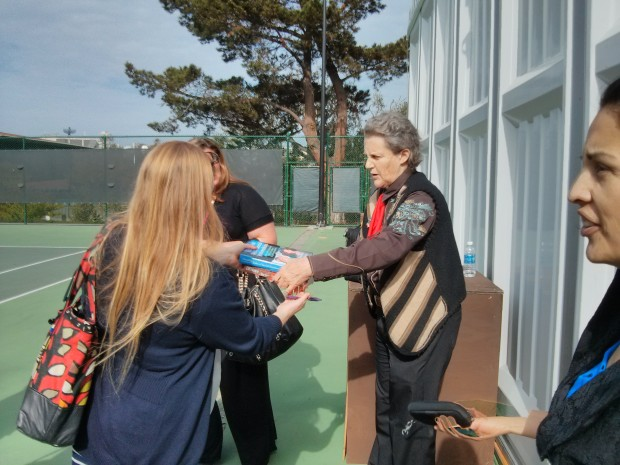 Grandin signing one of her books after giving a presentation on the strengths of the autistic mind.