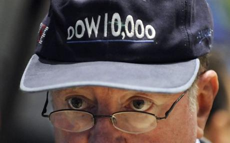 Dow slids below 10,000, watched by trader Arthur Cashin wearing a 'Dow 10,000' hat that was given out when the index first hit 10,000 on March 29, 1999