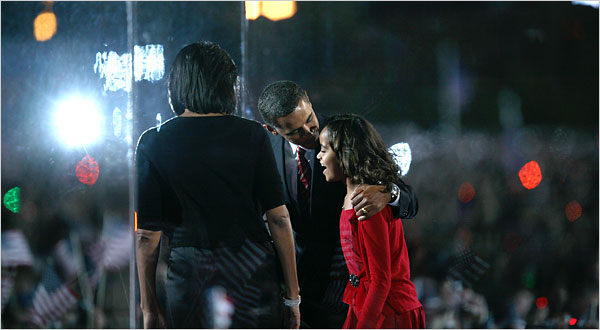 Senator Barack Obama kissed his daughter Malia while his wife, Michelle, looked on Tuesday night in Chicago.