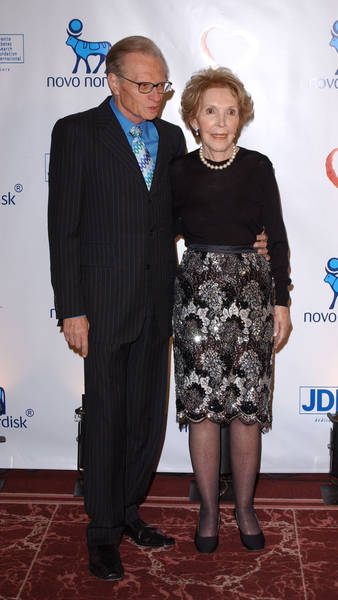Nancy Reagan stands with Larry King