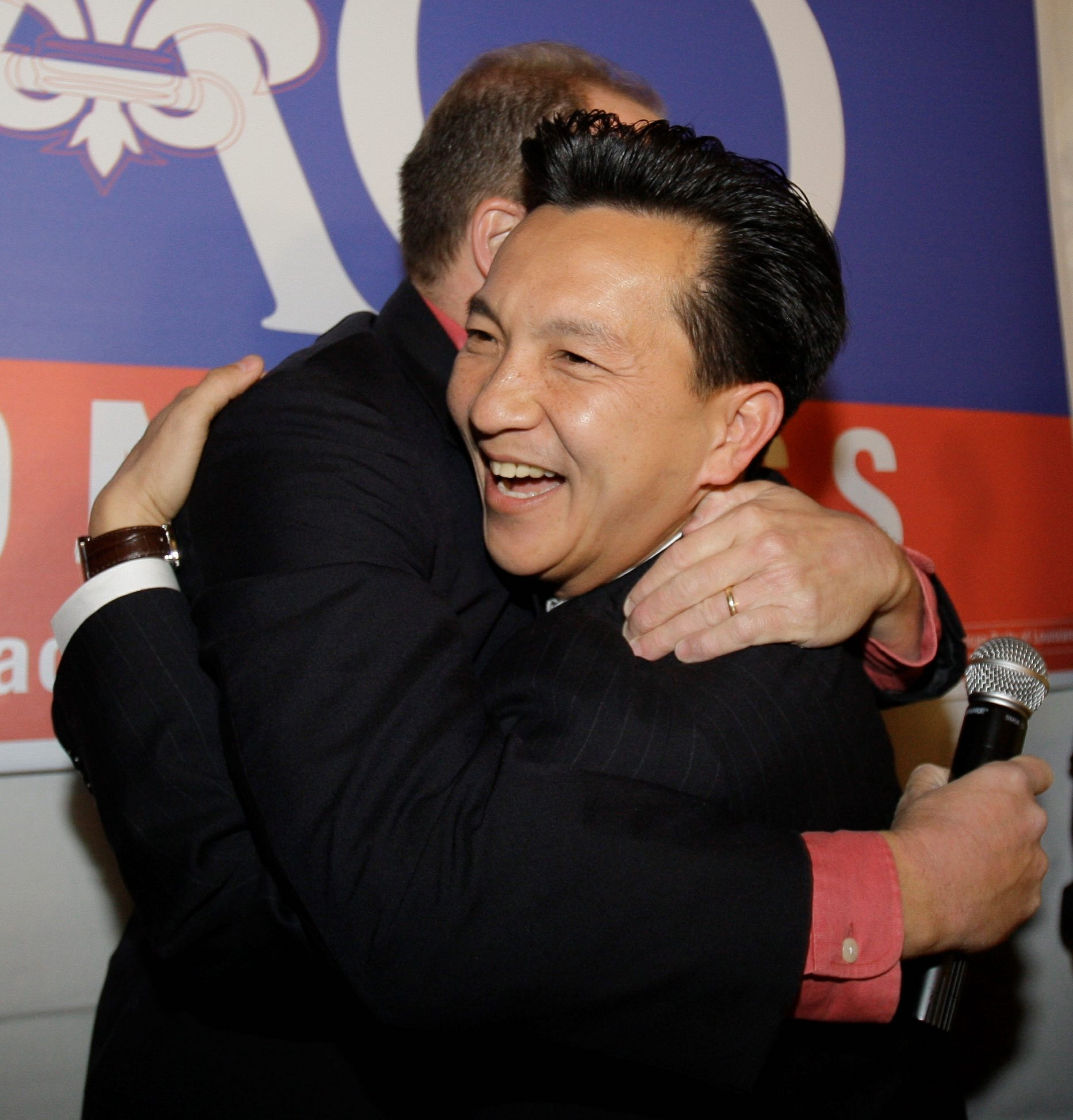 Republican Anh 'Joseph' Cao (right) hugs Rep. Steve Scalise after defeating Rep. William Jefferson for a House seat.