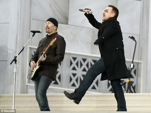 U2's Bono, right, and The Edge perform In the Name of Love