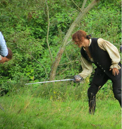 Man with sword in Pollok Park ! Barney had his fiercest growl ready but phew it was just the filming of outlander :)
