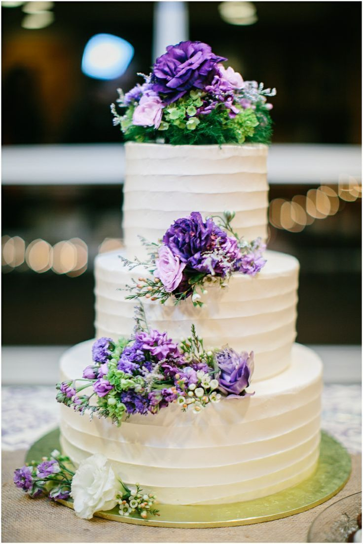 wedding cake with flowers down one side wedding cakes outlandish events 26880