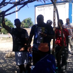 Pastor Brandon Kennedy, preaches to a group of people in Los Cocos.