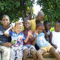Angelo Carrera, the son of Pastor Ruddy Carrera, with village children.