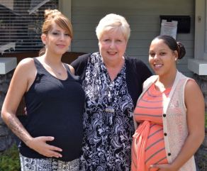 Photo by Nick Ostiller / OUTLOOK Elizabeth House Director of Programs Terry Bright is flanked by residents Kristen Perkowski and Melissa Hanley, both of whom are pregnant. Perkowski and Hanley became roommates at Elizabeth House in March.