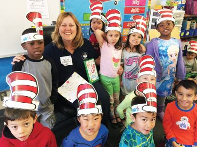 Photo courtesy Pasadena Unified School District Dawn O'Keeffe of the Pasadena Educational Foundation reads to a kindergarten class at Don Benito Elementary.