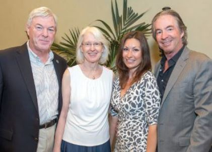 OUTLOOK file photo Professional Child Development Associates Executive Director Dr. Diane Cullinane and Harvest Moon Gala chair Chelby Crawford are flanked by Bill Cullinane (left) and Gregg Smith in preparation of this year's PCDA event, which will be held Sunday, Oct. 1.