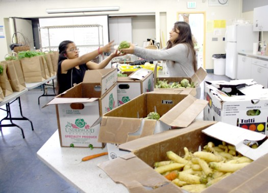 "Photos by Merin McDonald / OUTLOOK Mariela Cortez and Jahaira Ruiz help fill orders for Muir Ranch's Community Supported Agriculture program. In addition to produce from the ranch, CSA boxes are supplemented with discounted ""ugly"" produce from local farmers."