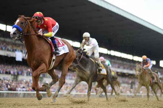 Photo courtesy Coglianese Photos / Adam Coglianese Justify, trained by La Cañada Flintridge resident Bob Baffert, became the 13th horse to win the Triple Crown with a victory Saturday in the Belmont Stakes.
