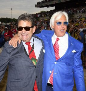 Photo courtesy Coglianese Photos / Adam Coglianese Trainer Bob Baffert (right) and his assistant trainer Jimmy Barnes embrace after Justify's wire-to-wire victory at the Belmont Stakes.