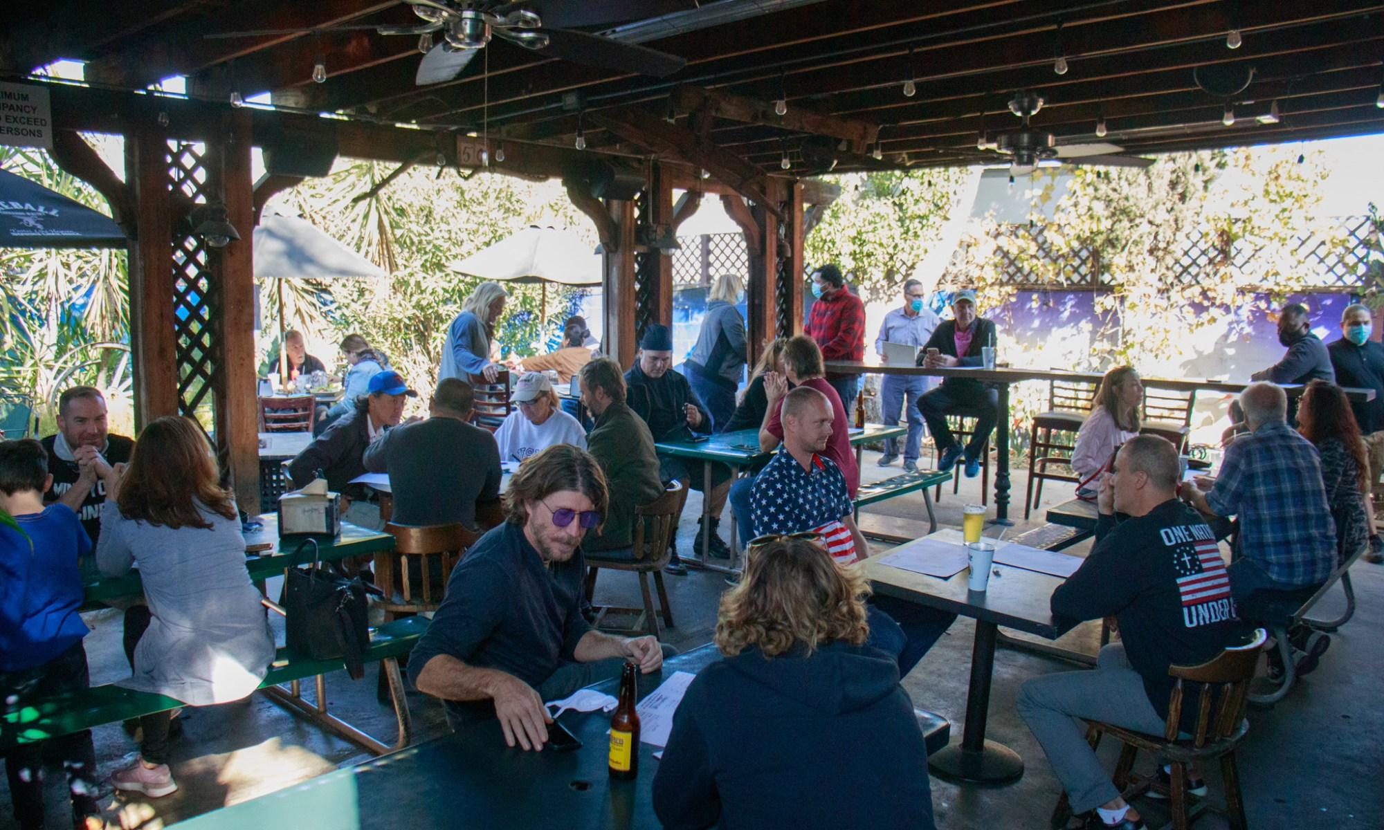 Dozens of patrons sit at the outdoor patio of the Tinhorn Flats Saloon and Grill in Burbank