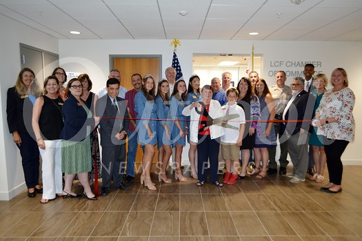 Pat Anderson cuts the ribbon at the Chamber of Commerce's new location.