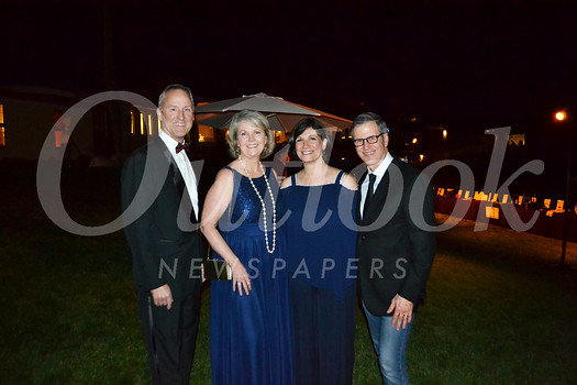 Board chair Brian Spaulding, Executive Director Lisa Cavelier, and hosts Margaret and David Mgrublian