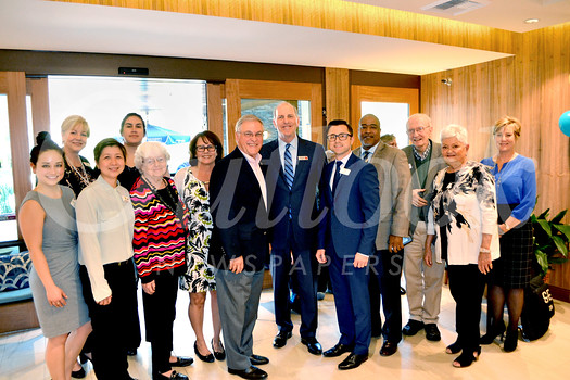 Villa Gardens Executive team and residents celebrate reopening