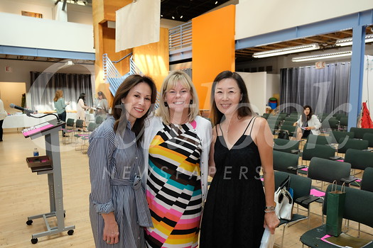 Hearts and Hands co-chairs Liz Lichtman and Mary Lee flank President Alison McCrary