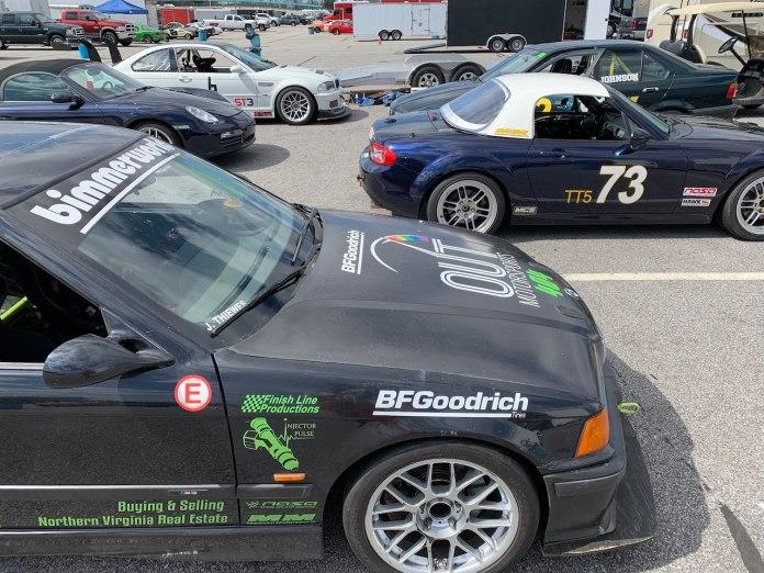 VIR paddock with BMW and Miata cars