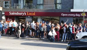 'Kiss in' protest at Sainsbury's after gay couple ejected