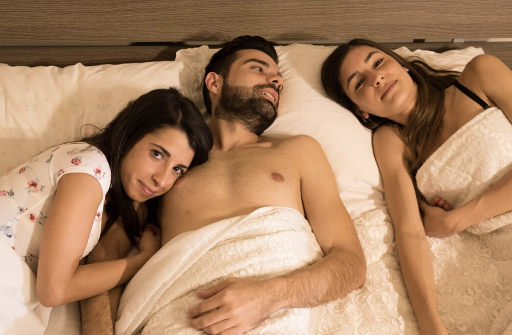 Threesome with two women and one man