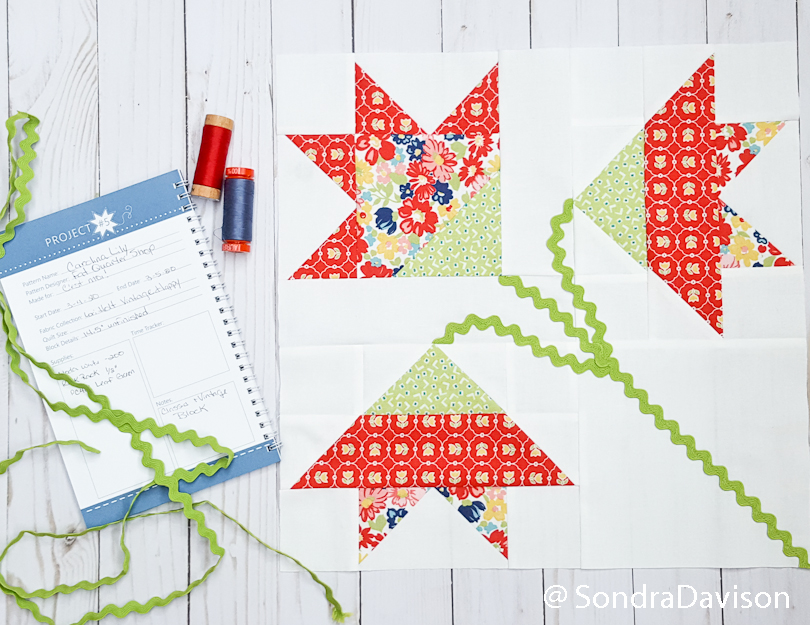 finished Carolina Lily quilt block with quilting journal