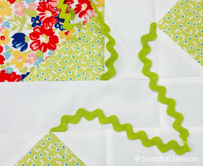 using rick rack for flower stems on quilt block
