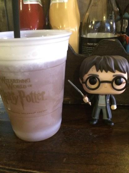 Harry needed some help drinking this frozen Butterbeer