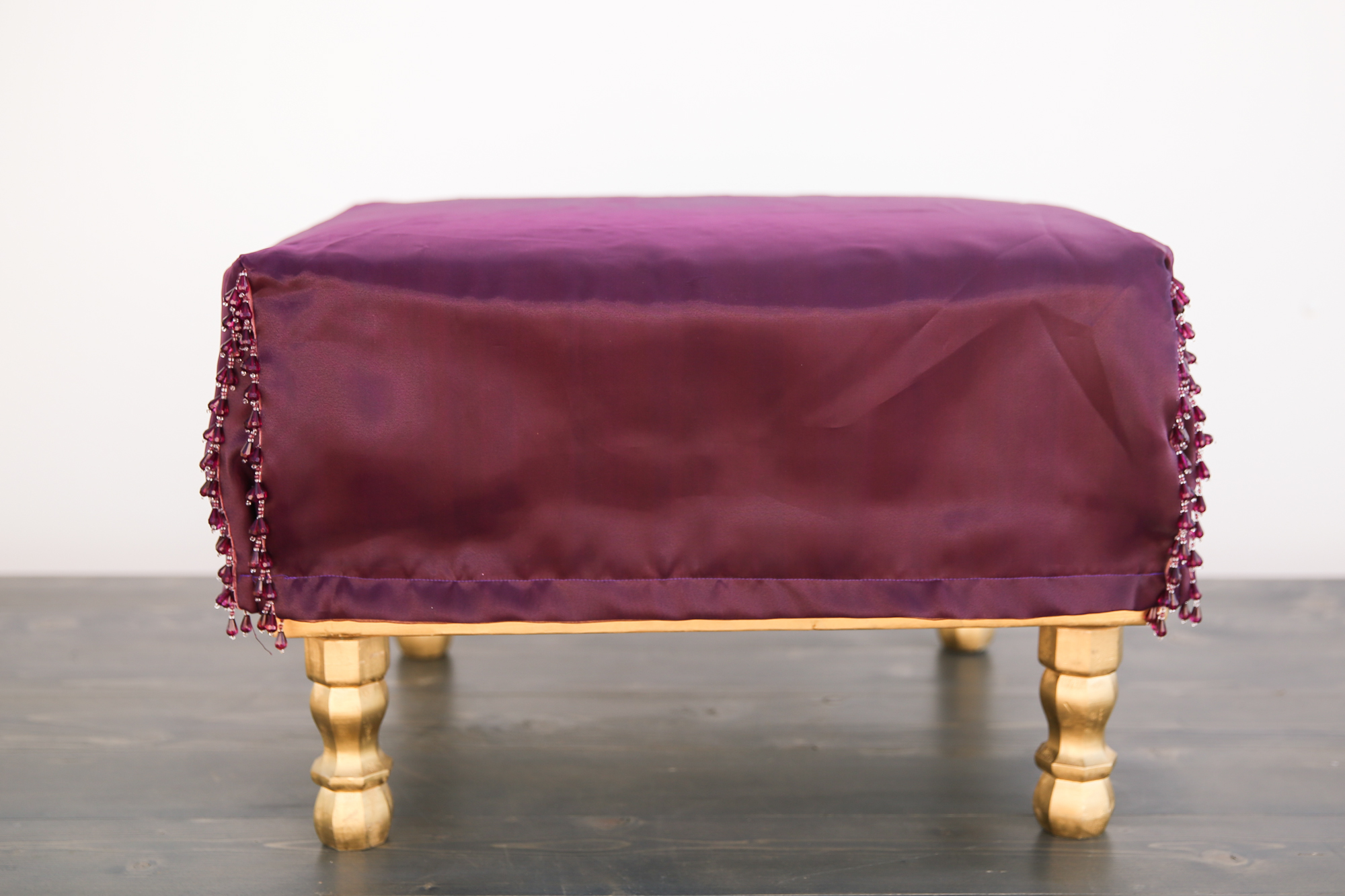 places to rent chair covers near me leather reception chairs gold leg ottoman with burgundy out of the dust rentals