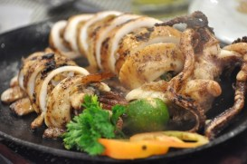 Sizzling Squid Stuffed with Lechon Sisig