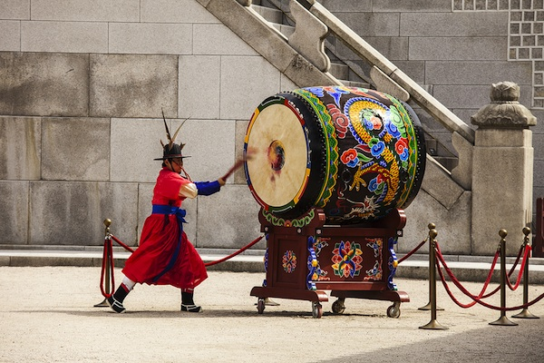 Stiking the Ceremonial Drum in Seoul Korea