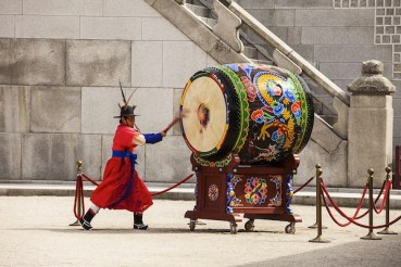 Stiking the Ceremonial Drum in Seoul Korea