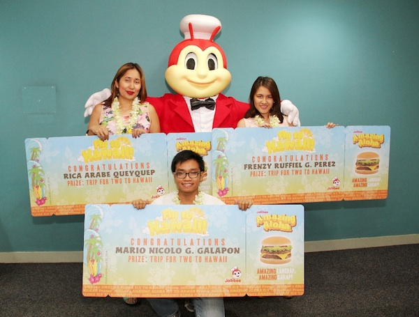 The Amazing Aloha Fly to Hawaii promo winners flashed big smiles as they posed with Jollibee