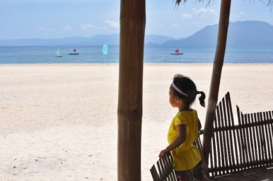 A local kid inside the Bamboo Cottage