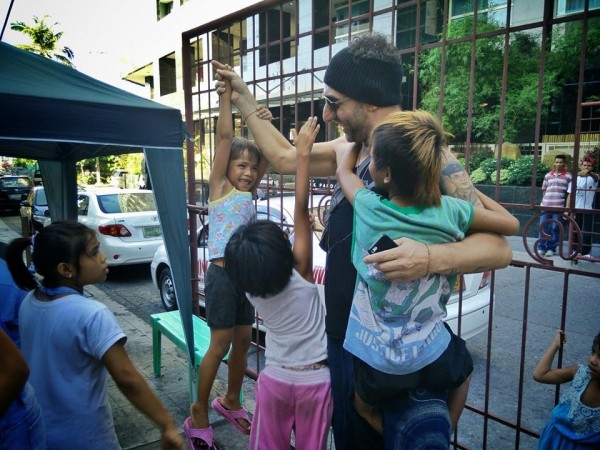 Vince playing with the street kids - photo by Marc Caballero