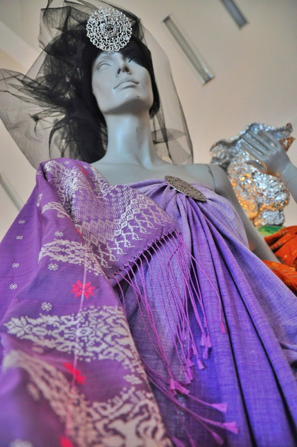 Mannequin wearing a dress made with Songket Fabric