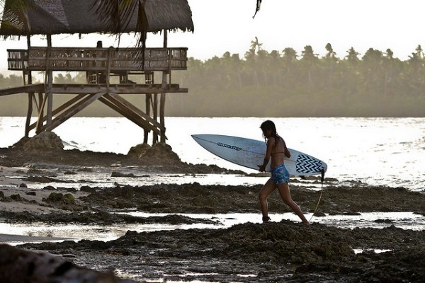Surfing in Siargao by Miguel Navaza