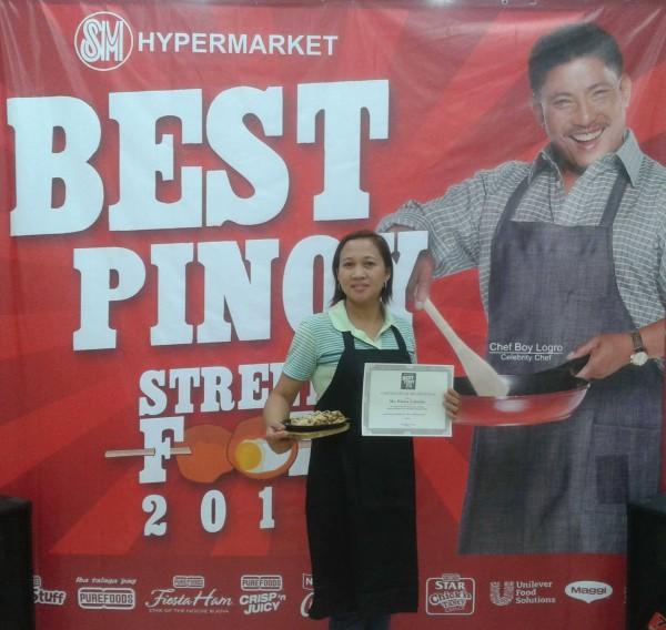 Winner of SM Hypermarket Batangas' elimination round, Eloisa Cabrales, with her winning Sizzling Sisig Pasta.