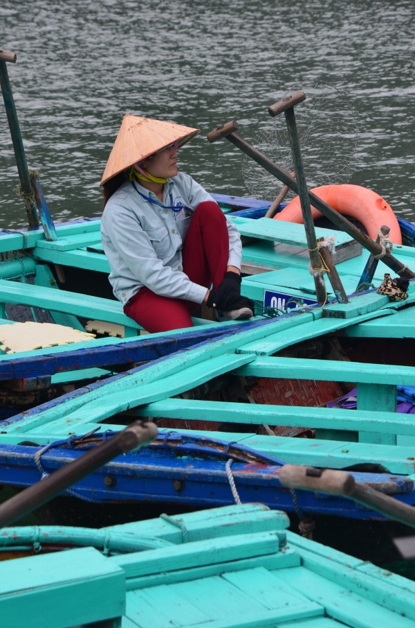 Female Boat Paddler waiting for passengers