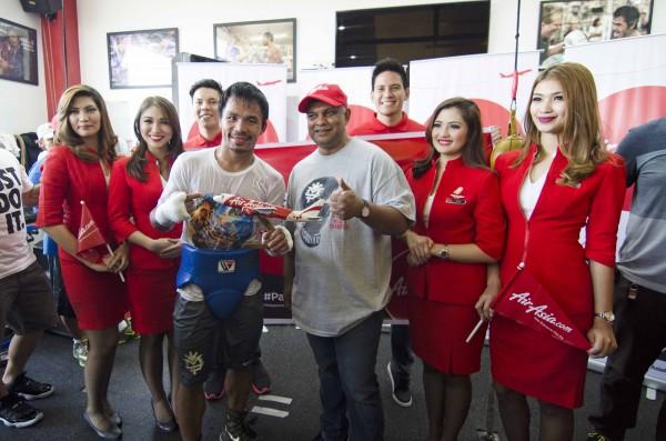 Pacman with Tony Fernandez holding the AirAsia Prototype